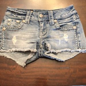 Miss me destructed shorts.  Size 22